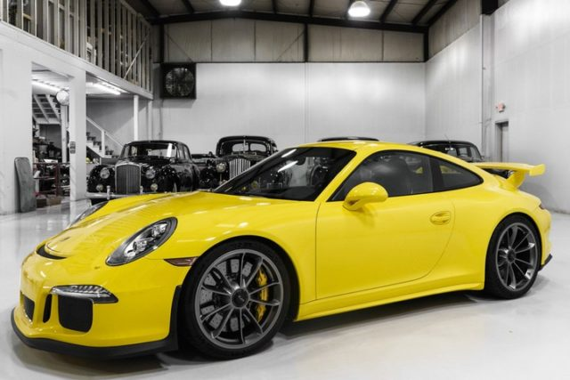 The magnificent 2015 Porsche 911 Carrera GT3 Coupe feature here is finished in special-ordered racing yellow over black leather interior. This incredible one-owner motorcar was special-ordered with an extensive list of options totaling nearly $40,000, including Porsche composite brakes and front axle lift system.  - - - - #porsche #classiccars #GT3 #pdk #racecar #sportscar #carphoto #porschelife #carrera #racingyellow
